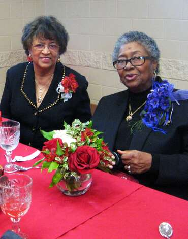 "Dolores Sennette and Verlene Davenport, two ""Delta Dears,"" as veteran members of Delta Sigma Theta Sorority are called, at a luncheon Saturday. The sorority sisters of the Beaumont chapter, established in 1942, were celebrating the national organization's 100th birthday Jan. 13. Photo: Sarah Moore"