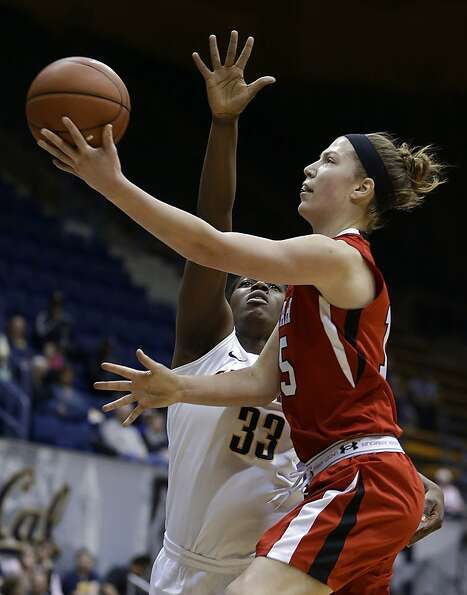 Utah's Michelle Plouffe, right, lays up a shot against California's Talia Caldwell (33) in the first