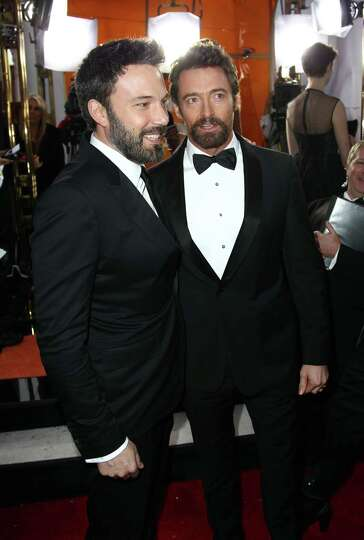 Director Ben Affleck, left, and actor Hugh Jackman arrive at the 19th Annual Screen Actors Guild Awa