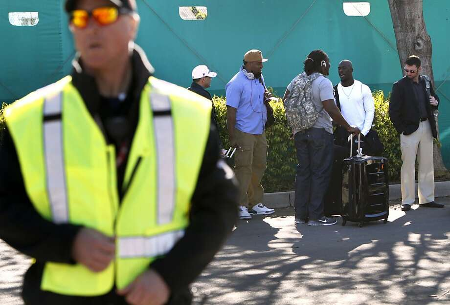 The 49ers line up for buses leaving their practice facility in Santa Clara, Calif., Sunday, January 27, 2013, for New Orleans and the Super Bowl. Photo: Sarah Rice, Special To The Chronicle