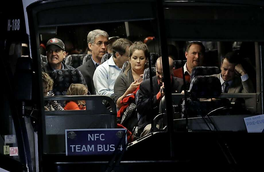 San Francisco 49ers head coach Jim Harbaugh makes a face on the team bus after arriving at the Louis Armstrong International Airport for the NFL Super Bowl XLVII football game Sunday, Jan. 27, 2013, in New Orleans. (AP Photo/David J. Phillip) Photo: David J. Phillip, Associated Press