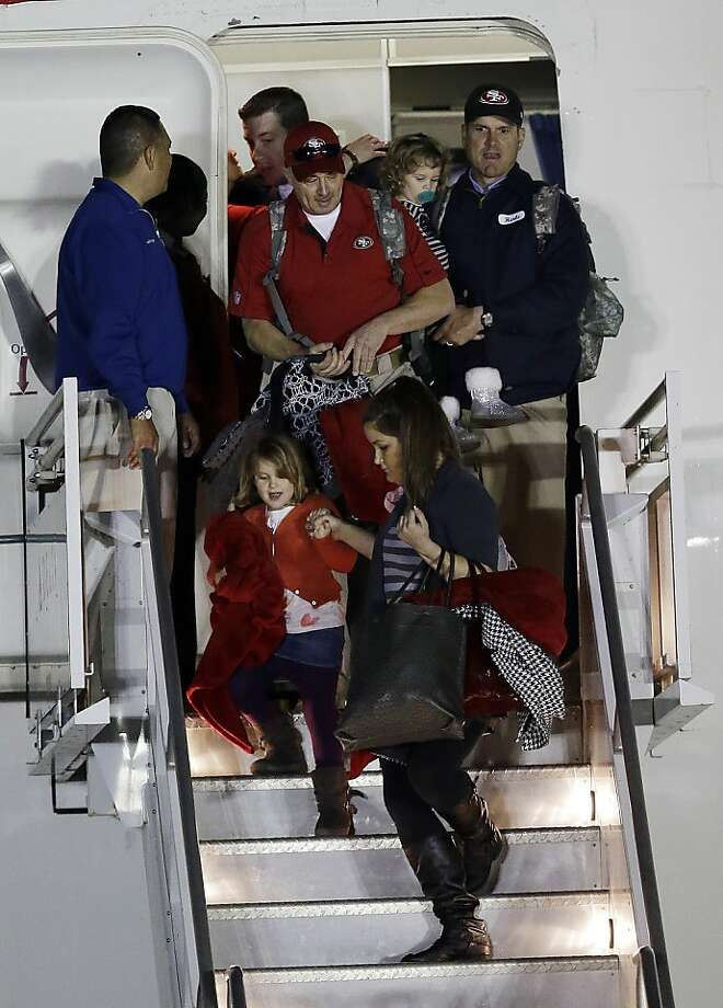 San Francisco 49ers head coach Jim Harbaugh arrives at the Louis Armstrong International Airport for the NFL Super Bowl XLVII football game Sunday, Jan. 27, 2013, in New Orleans. (AP Photo/David J. Phillip) Photo: David J. Phillip, Associated Press