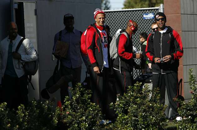 Colin Kaepernick, center, and Michael Crabtree, right, leave the 49ers  practice facility in Santa Clara, Calif., Sunday, January 27, 2013, for New Orleans and the Super Bowl. Photo: Sarah Rice, Special To The Chronicle