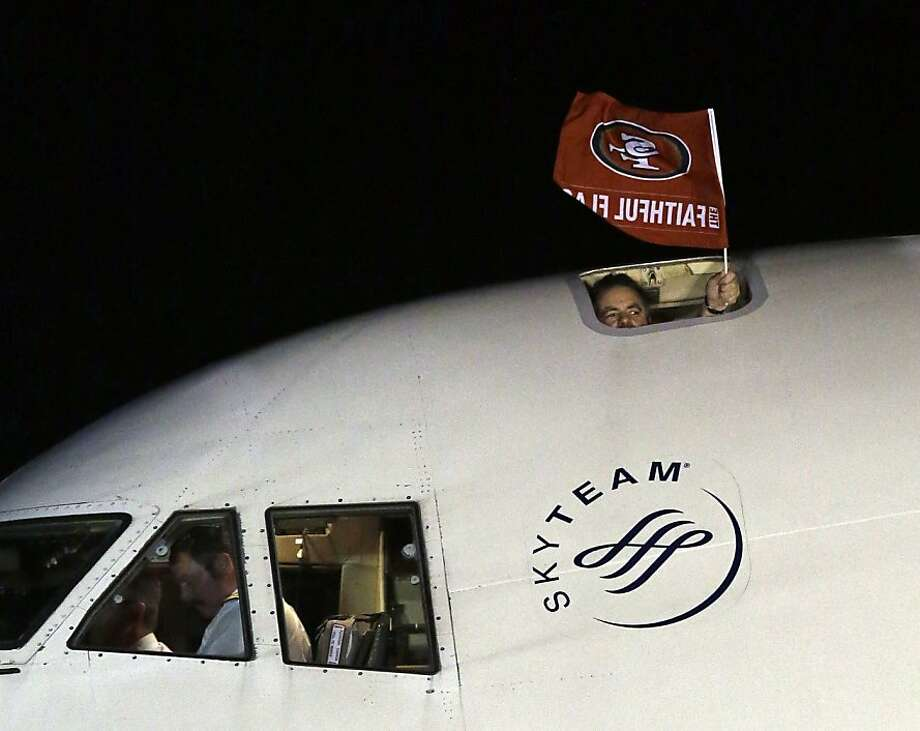 A flag is seen outside the plane carrying the San Francisco 49ers as they arrive at the Louis Armstrong International Airport for the NFL Super Bowl XLVII football game Sunday, Jan. 27, 2013, in New Orleans. (AP Photo/David J. Phillip) Photo: David J. Phillip, Associated Press