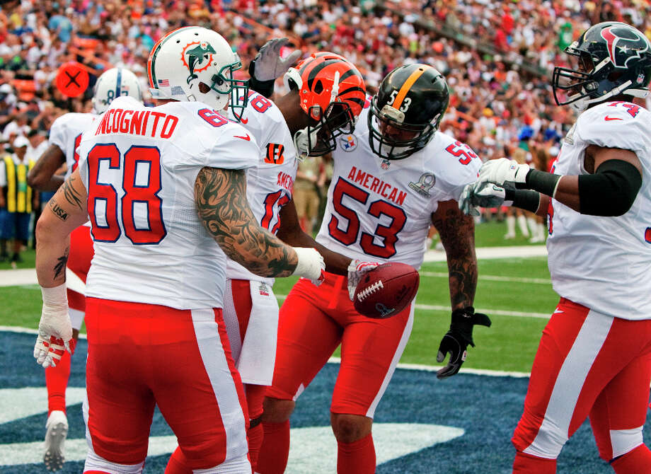 Dolphins guard Richie Incognito (68), Steelers center Maukice Pouncey (53), and Texans guard Wade Smith (74), congratulate Bengals wide receiver A.J. Green (18) on his touchdown. Photo: Marco Garcia, Associated Press / FR132415 AP