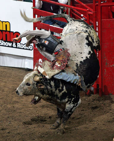 Wes Bilyeu of Ontario, Ore., rides Crossfire during the bull riding competition at the San Antonio Stock Show & Rodeo on Feb. 8, 2005. Photo: Kin Man Hui, San Antonio Express-News