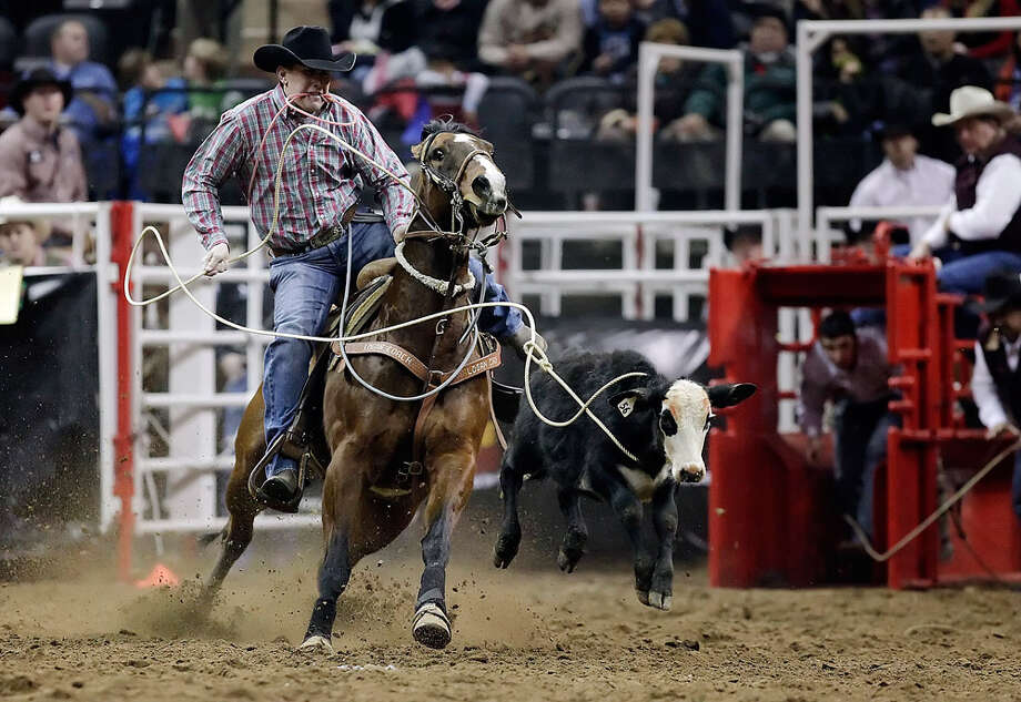 Nate Baldwin of Blackfoot, Ind., competes in the tie-down roping event at the San Antonio Stock Show & Rodeo on Feb. 10, 2010. Photo: Kin Man Hui, San Antonio Express-News