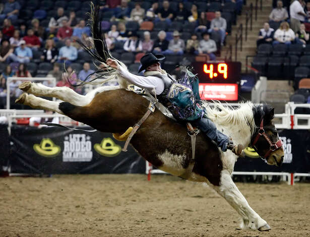 Kyle Bowers, of Brooks, Alberta, extends his ride during the bareback riding competition on Feb. 11, 2009, at the San Antonio Stock Show & Rodeo. Photo: Kin Man Hui, San Antonio Express-News