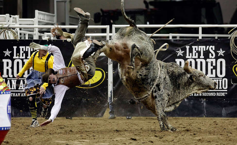 Seth Glause of Rock Springs, Wyo., gets thrown from Slick Willie during the bull riding competition at the San Antonio Stock Show & Rodeo on Feb. 5, 2010. Photo: Kin Man Hui, San Antonio Express-News