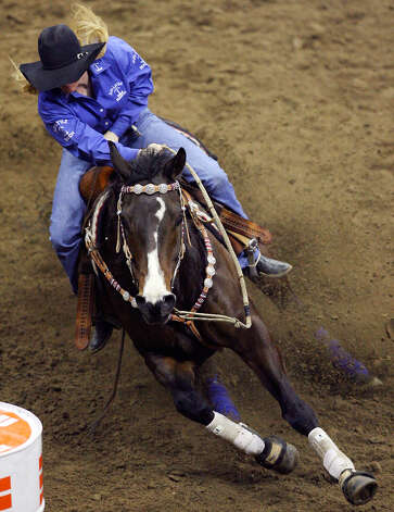 Tiffany Fox, of Fox, Okla., competes in barrel racing on Feb. 11, 2008, during the San Antonio Stock Show & Rodeo at the AT&T Center. Fox's time was 14.58. Photo: Edward A. Ornelas, San Antonio Express-News