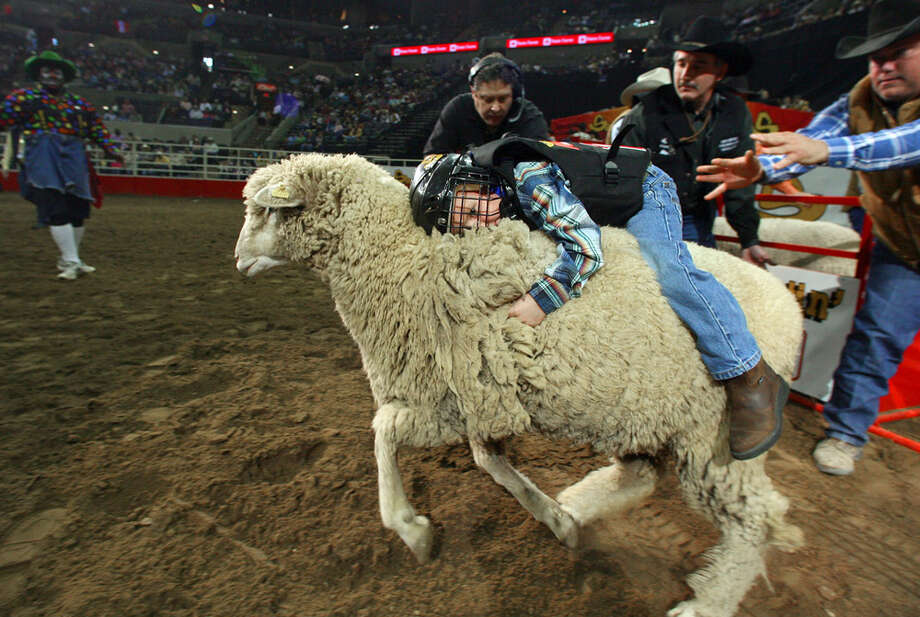 Adam Bell, 4, competes in the mutton bustin' event at the San Antonio Stock Show & Rodeo at the AT&T Center on Feb. 4, 2007. Photo: Edward A. Ornelas, San Antonio Express-News