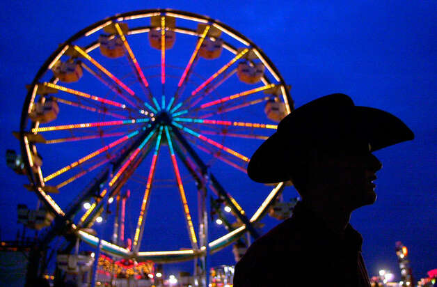 San Antonian William Womack takes in the midway sites on the final day of the San Antonio Stock Show & Rodeo Feb. 20, 2000. Photo: Edward A. Ornelas, San Antonio Express-News