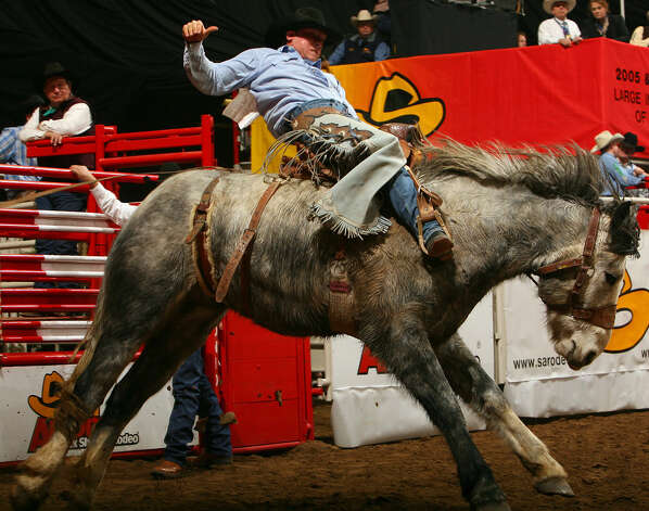 Matt Hebbert, from Hyannis, Neb., competes in the saddle bronc event at the San Antonio Stock Show & Rodeo on Feb. 4, 2007. Photo: Edward A. Ornelas, San Antonio Express-News