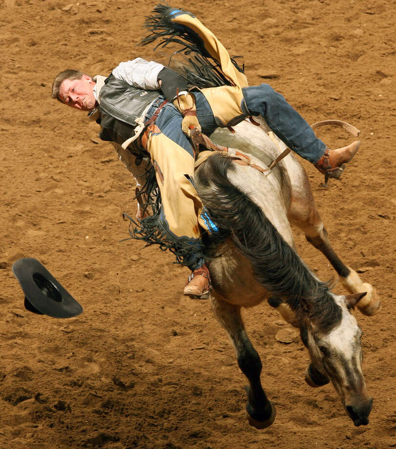 Dustin Reeves, from Owanka, S.D., competes in the bareback riding event during the San Antonio Stock Show & Rodeo at the AT&T Center on Feb. 11, 2007. Reeves scored a 76 on the ride. Photo: Edward A. Ornelas, San Antonio Express-News