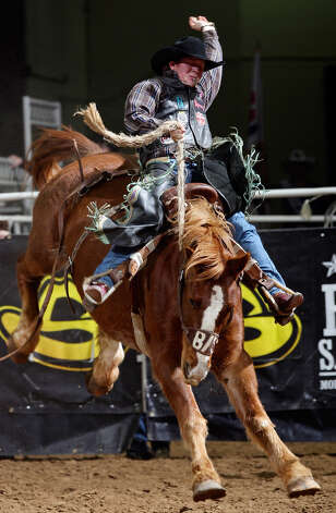 Jacobs Crawley of College Station competes in the saddle bronc riding event during the San Antonio Stock Show & Rodeo on Feb. 9, 2012, at the AT&T Center. Crawley scored an 82 on the ride. Photo: Edward A. Ornelas, San Antonio Express-News