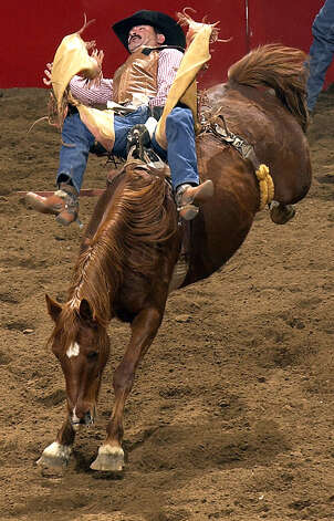 Chuck Logue competes in the bareback bronc riding competition at the San Antonio Stock Show & Rodeo on Feb. 4, 2003, at the SBC Center. Photo: William Luther, San Antonio Express-News