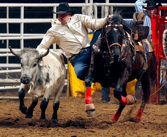 Shaun Greenfield, of Lakeview, Ore., competes in the steer wrestling event during the San Antonio Stock Show & Rodeo on Feb. 13, 2007 at the AT&T Center. Greenfield finished with an arena record of 3.2 seconds. Photo: William Luther, San Antonio Express-News