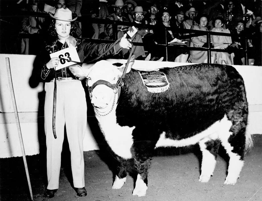 A livestock show participant shows off her entry at the San Antonio Stock Show & Rodeo in this undated photo. Photo: San Antonio Express-News File Photo