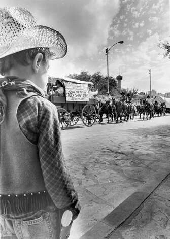 A young cowboy wears his rodeo finest to watch the parade marking the beginning of the 1987 San Antonio Stock Show & Rodeo as it makes its way through downtown. Photo: San Antonio Express-News File Photo