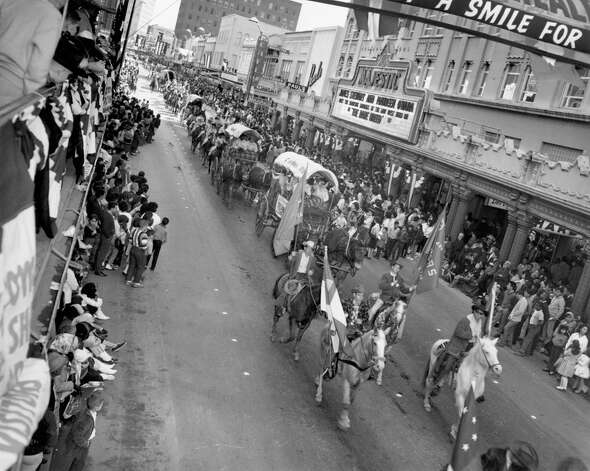 The parade marking the beginning of the San Antonio Stock Show & Rodeo passes by the Majestic Theatre as it makes its way through downtown in this undated photo. Photo: San Antonio Express-News File Photo