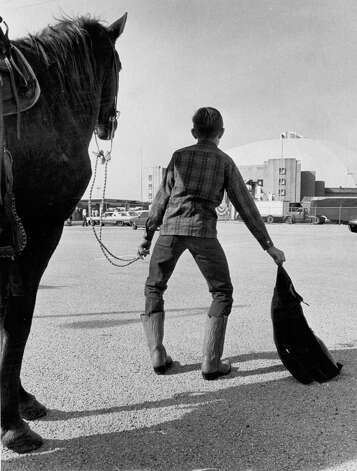 A young rider is bow-legged after arriving at Freeman Coliseum for the San Antonio Stock Show & Rodeo in this undated photo. Photo: San Antonio Express-News File Photo