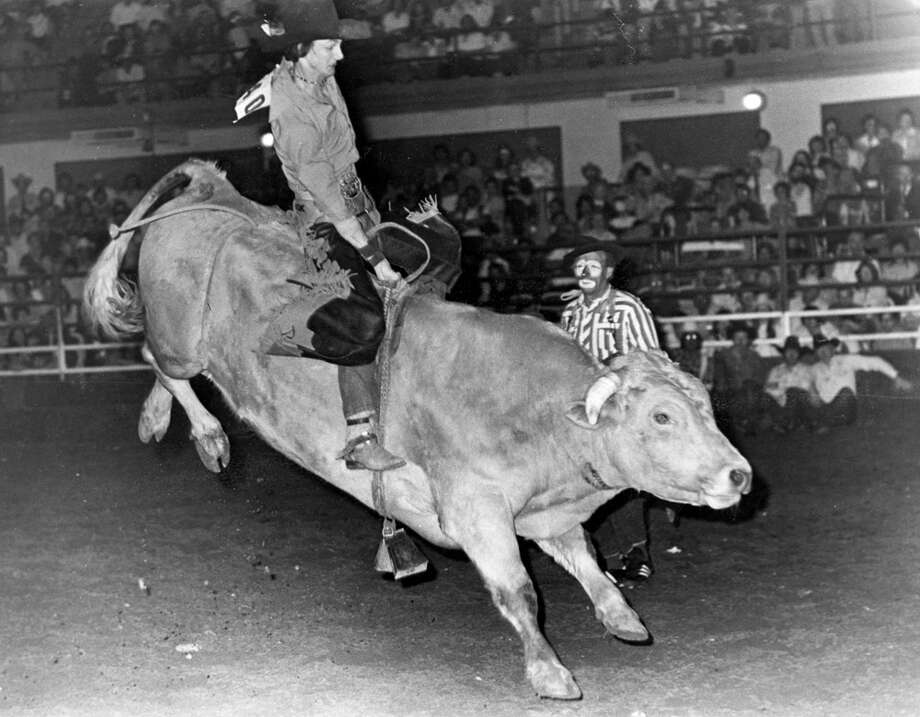 A cowboy competes in bull riding at the San Antonio Stock Show & Rodeo in this undated photo. Photo: San Antonio Express-News File Photo
