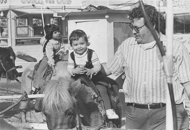 Kathy Wilbur, 1, rides a pony as her father Joseph Wilbur, both of San Antonio, attend the San Antonio Stock Show & Rodeo on Feb. 12, 1979. Photo: San Antonio Express-News File Photo