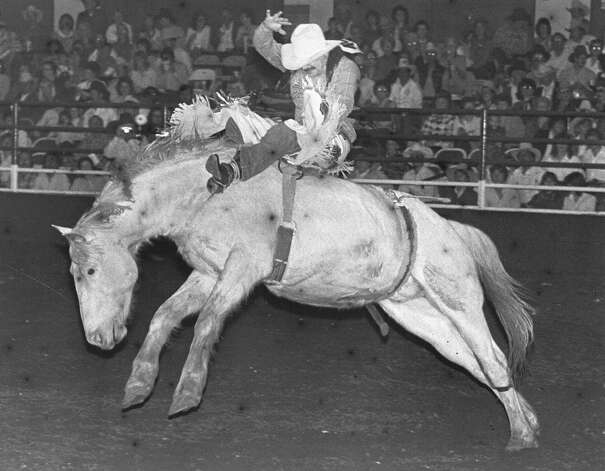 Chuck Logue rides Snowball BJ in the bareback bronc competition at the San Antonio Stock Show & Rodeo on Feb. 15, 1984. Photo: San Antonio Express-News File Photo