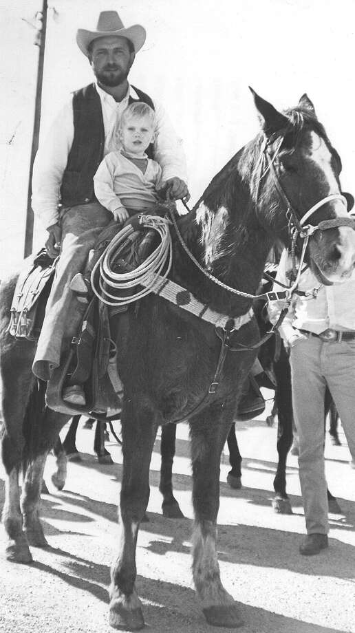 Ray Isley of Stonewall, with his 3-year-old son Buger, arrives at Freeman Coliseum for the San Antonio Stock Show & Rodeo in February 1970. Photo: San Antonio Express-News File Photo