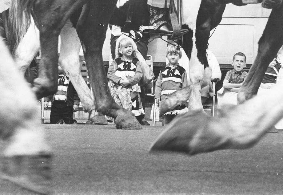 Lesa Fookes, 6, and Lori Fookes, 4, watch the San Antonio Stock Show & Rodeo parade make its way through downtown on Feb. 13, 1970. Photo: San Antonio Express-News File Photo