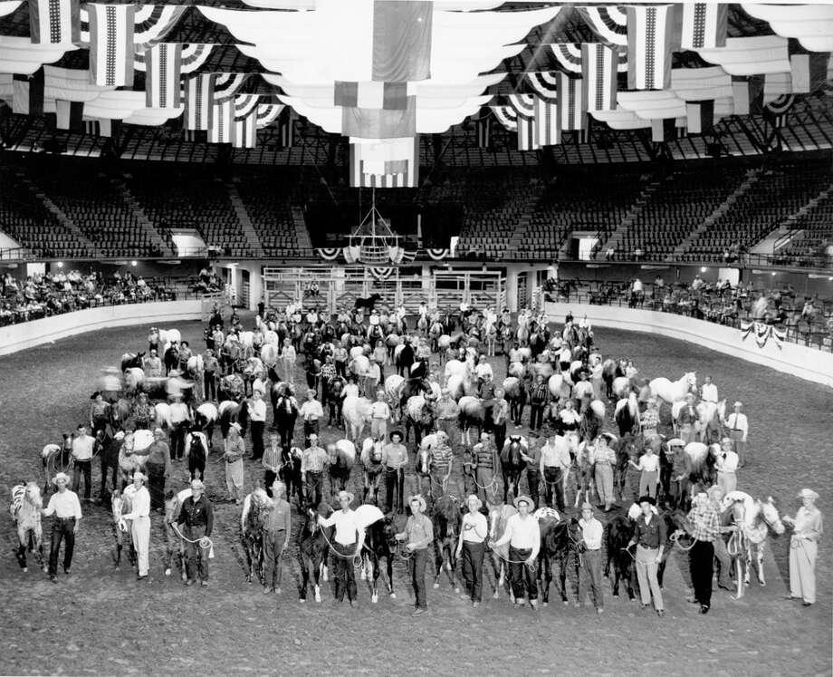 San Antonio Stock Show & Rodeo participants pose in Freeman Coliseum in this undated photo. Photo: San Antonio Express-News File Photo