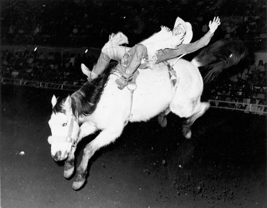 A cowboy competes in bareback riding at the San Antonio Stock Show & Rodeo in this undated photo. Photo: San Antonio Express-News File Photo