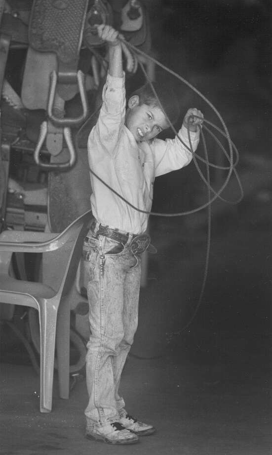 Chance Zaiontz, 7, tries out his roping skills in the horse barn at the San Antonio Stock Show & Rodeo on Feb. 11, 1993. Photo: San Antonio Express-News File Photo