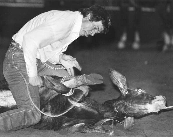 Johnny Sloane of Ellensburg, Wa., is all concentration as he ropes a calf during slack calf roping at the San Antonio Stock Show & Rodeo on Feb. 11, 1986. His time was 9.3 on this attempt. Photo: San Antonio Express-News File Photo