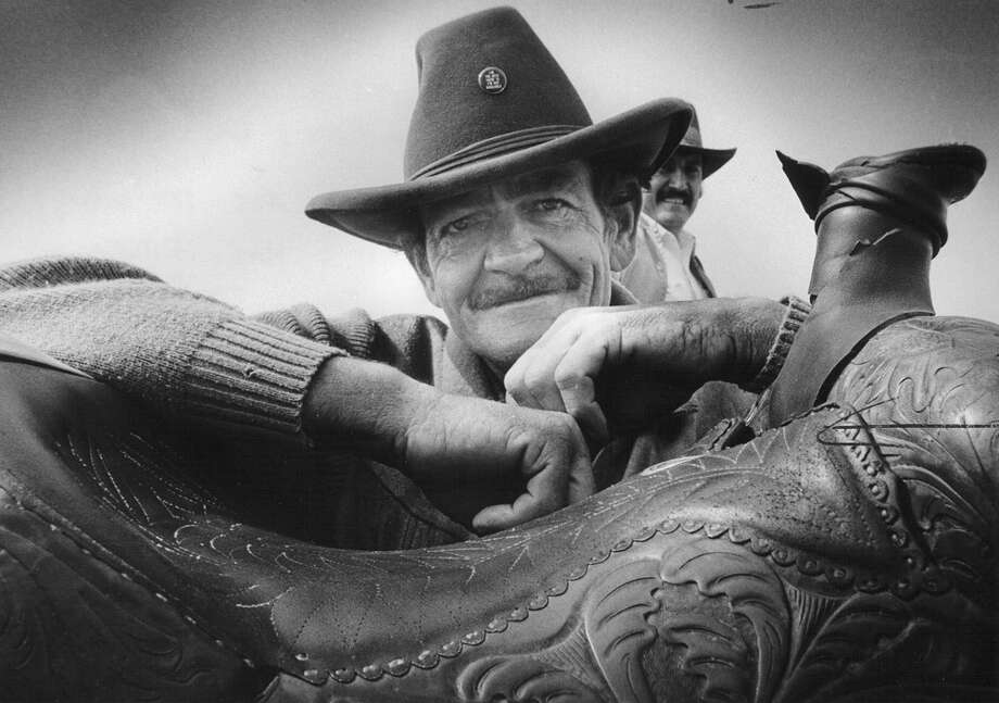Jim Howard, a rider with the International Laredo Trail Ride, is seen north of Von Ormy on Interstate 35 on Feb. 5, 1986, after riding all the way from Laredo to get to the San Antonio Stock Show & Rodeo. He has ridden the route for the past 13 years. Photo: San Antonio Express-News File Photo