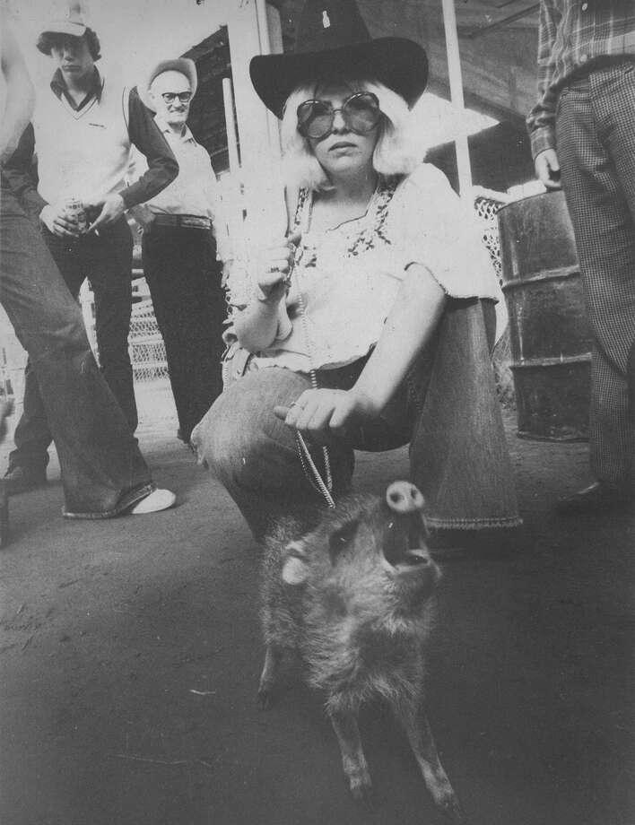 Georgina Phillips of Killbuck, Ohio, attends the San Antonio Stock Show & Rodeo with her javelina Lena on Feb. 13, 1977. Photo: San Antonio Express-News File Photo