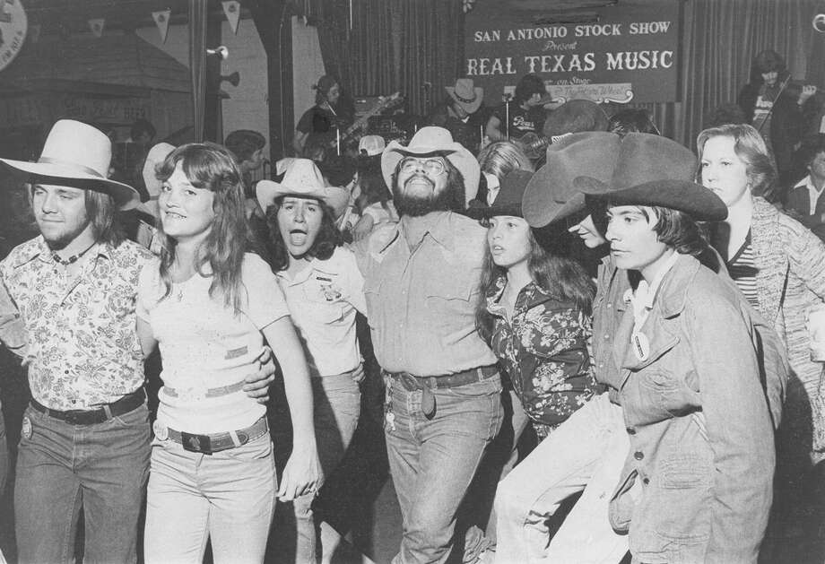 "Concert goers dance to the ""Cotton-Eyed Joe"" at the Real Texas Music event at the San Antonio Stock Show & Rodeo on Feb. 11, 1977. Photo: San Antonio Express-News File Photo"