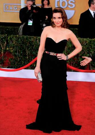 Tina Fey arrives at the 19th Annual Screen Actors Guild Awards at the Shrine Auditorium in Los Angeles on Sunday, Jan. 27, 2013. (Photo by Chris Pizzello/Invision/AP) Photo: Chris Pizzello, Associated Press / Invision