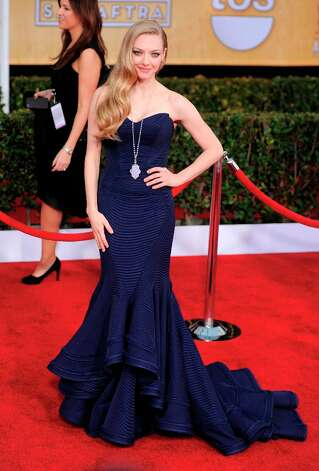Actress Amanda Seyfried arrives at the 19th Annual Screen Actors Guild Awards at the Shrine Auditorium in Los Angeles on Sunday Jan. 27, 2013. (Photo by Chris Pizzello/Invision/AP) Photo: Chris Pizzello, Associated Press / Invision
