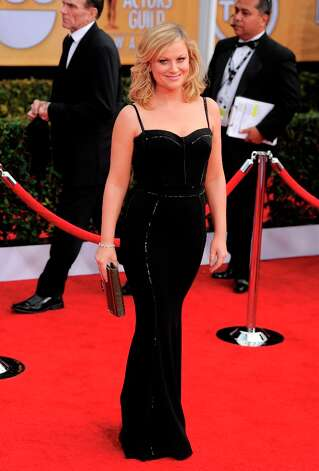 Amy Poehler arrives at the 19th Annual Screen Actors Guild Awards at the Shrine Auditorium in Los Angeles on Sunday Jan. 27, 2013. (Photo by Chris Pizzello/Invision/AP) Photo: Chris Pizzello, Associated Press / Invision