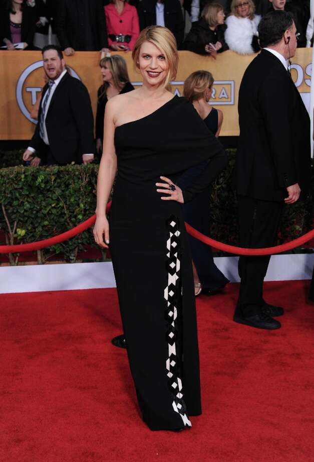 Claire Danes arrives at the 19th Annual Screen Actors Guild Awards at the Shrine Auditorium in Los Angeles on Sunday, Jan. 27, 2013. (Photo by Jordan Strauss/Invision/AP) Photo: Jordan Strauss, Associated Press / Invision