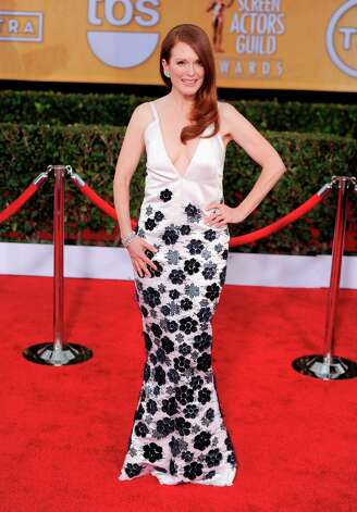 Julianne Moore arrives at the 19th Annual Screen Actors Guild Awards at the Shrine Auditorium in Los Angeles on Sunday Jan. 27, 2013. (Photo by Chris Pizzello/Invision/AP) Photo: Chris Pizzello, Associated Press / Invision