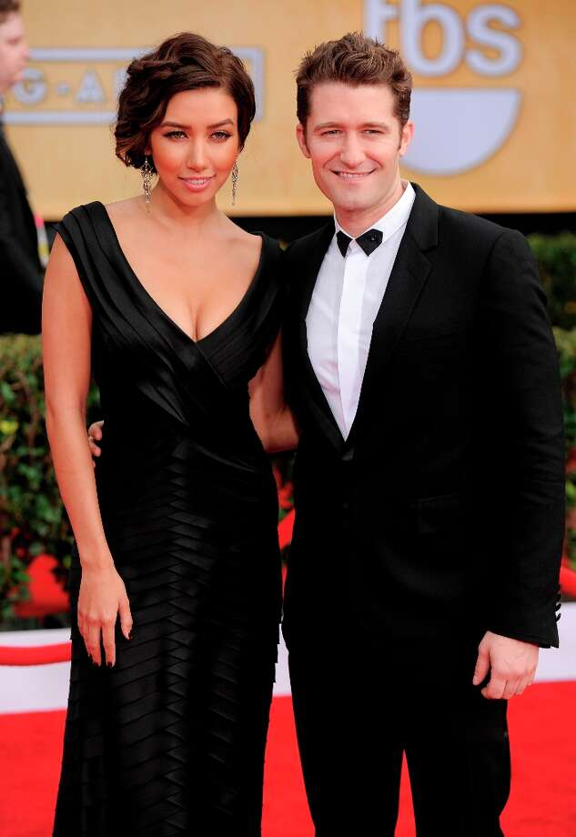 Renee Puente, left, and Matthew Morrison arrive at the 19th Annual Screen Actors Guild Awards at the Shrine Auditorium in Los Angeles on Sunday Jan. 27, 2013. (Photo by Chris Pizzello/Invision/AP) Photo: Chris Pizzello, Associated Press / Invision