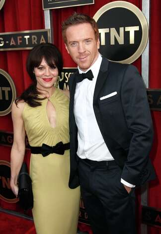 Helen McCrory, left, and actor Damian Lewis arrive at the 19th Annual Screen Actors Guild Awards at the Shrine Auditorium in Los Angeles on Sunday Jan. 27, 2013. (Photo by Matt Sayles/Invision/AP) Photo: Matt Sayles, Associated Press / Invision