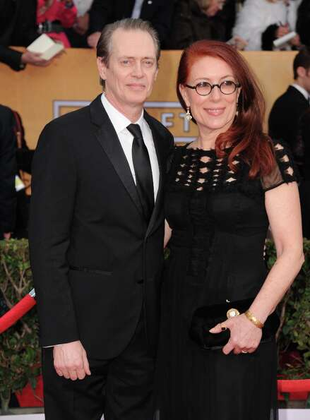Actor Steve Buscemi, left, and Jo Andres arrive at the 19th Annual Screen Actors Guild Awards at the