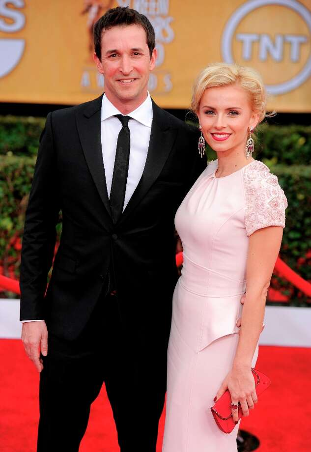 Actor Noah Wyle, left, and a guest arrive at the 19th Annual Screen Actors Guild Awards at the Shrine Auditorium in Los Angeles on Sunday, Jan. 27, 2013. (Photo by Chris Pizzello/Invision/AP) Photo: Chris Pizzello, Associated Press / Invision