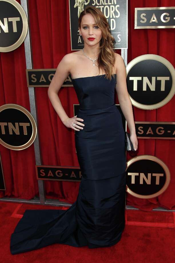 Actress Jennifer Lawrence arrives at the 19th Annual Screen Actors Guild Awards at the Shrine Auditorium in Los Angeles on Sunday, Jan. 27, 2013. (Photo by Matt Sayles/Invision/AP) Photo: Matt Sayles, Associated Press / Invision