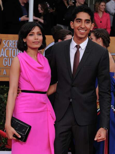Actors Freida Pinto, left, and Dev Patel arrive at the 19th Annual Screen Actors Guild Awards at the