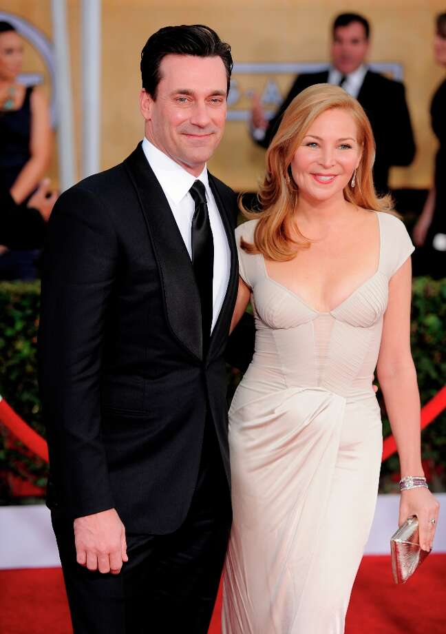 Jon Hamm, left, and Jennifer Westfeldt arrive at the 19th Annual Screen Actors Guild Awards at the Shrine Auditorium in Los Angeles on Sunday Jan. 27, 2013. (Photo by Chris Pizzello/Invision/AP) Photo: Chris Pizzello, Associated Press / Invision