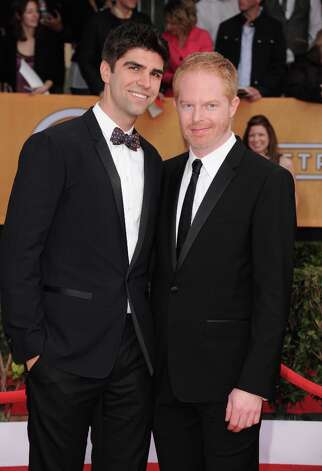Justin Mikita, left, and actor Jesse Tyler Ferguson arrive at the 19th Annual Screen Actors Guild Awards at the Shrine Auditorium in Los Angeles on Sunday, Jan. 27, 2013. (Photo by Jordan Strauss/Invision/AP) Photo: Jordan Strauss, Associated Press / Invision